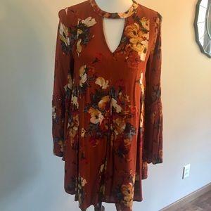 Burnt orange floral dress.